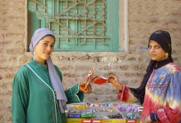 Two women selling candy